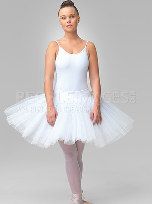Buy stock photo Portrait of a young and cute ballerina standing against white background