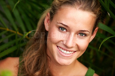 Buy stock photo Closeup portrait of cute young woman smiling in a park - Outdoor