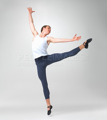 Buy stock photo Full length of a male ballet dancer performing against white background