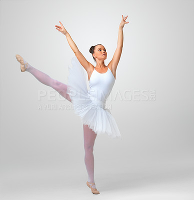 Buy stock photo Full length of a cute and beautiful ballerina dancing against white background - copyspace