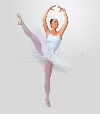 Buy stock photo Full length of a ballerina performing against white background - copyspace