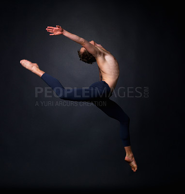 Buy stock photo Portrait of a male ballet dancer performing energetically against black background