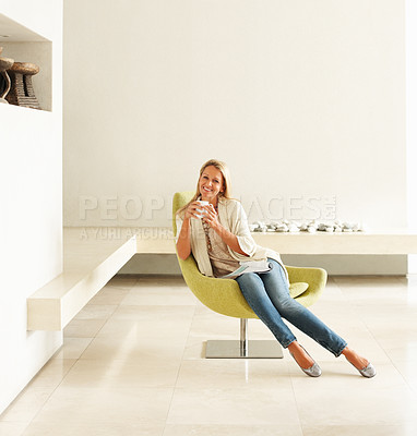 Buy stock photo Portrait of a smiling relaxed mature female with coffee cup at an empty modern room