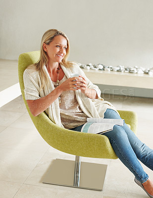 Buy stock photo A smiling mature woman relaxing with a cup of coffee