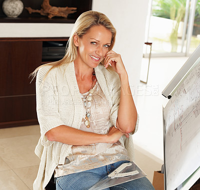 Buy stock photo Portrait of a relaxed female architect with construction plans on board