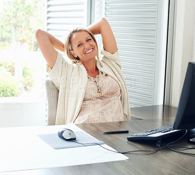 Buy stock photo Portrait of a happy mid adult female with computer on desk