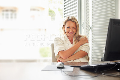 Buy stock photo Portrait of a charming mature business woman smiling at her work desk - copy space