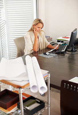 Buy stock photo Portrait of a female architect reading a document at office desk