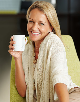 Buy stock photo Closeup portrait of a happy pretty woman holding a cup of tea or coffee