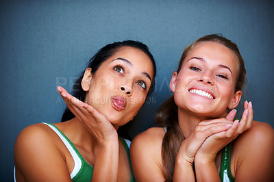 Buy stock photo Portrait of pretty young women making funny faces against grey background