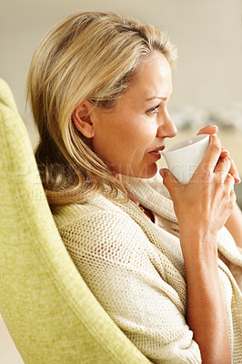 Buy stock photo Side view closeup of a pretty middle aged woman drinking tea