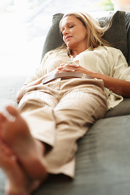 Buy stock photo Portrait of a beautiful middle aged woman sleeping on sofa