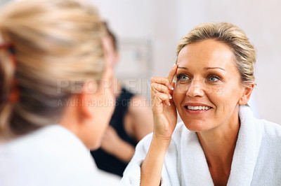 Buy stock photo Close-up of a beautiful mature woman admiring herself in the mirror