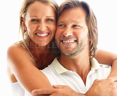 Buy stock photo Closeup of a happy woman embracing man from behind against white background