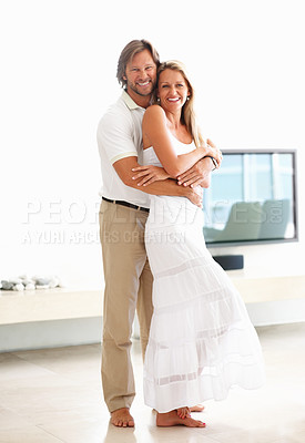 Buy stock photo Full length portrait of a loving mature man embracing a woman from behind