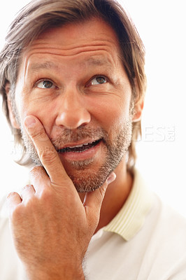 Buy stock photo Closeup portrait of a mature man with thoughtful expression against white background