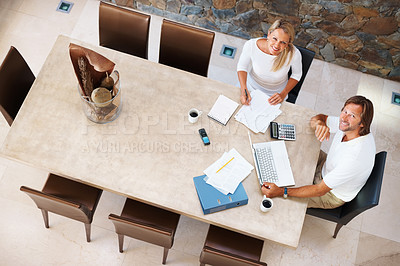 Buy stock photo Top view of a mature couple doing home finance at modern dining table , using laptop