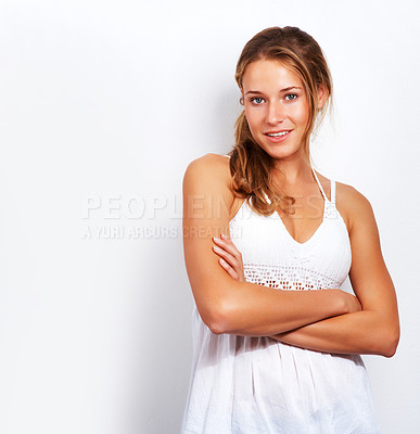 Buy stock photo Portrait of smart young woman standing with her hands folded and smiling against white background
