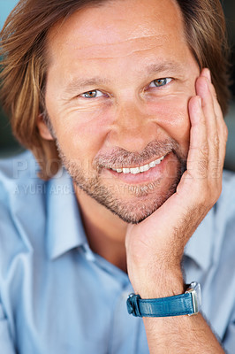 Buy stock photo Closeup of a happy relaxed mature man with hand on chin smiling