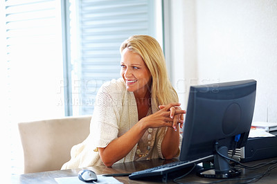 Buy stock photo A happy  mid adult female with computer at work desk