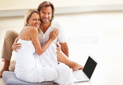 Buy stock photo Portrait of a happy romantic mature couple sitting on floor with a laptop