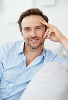 Buy stock photo Portrait of a happy young male relaxing on couch - Indoor