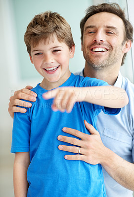 Buy stock photo Portrait of a young boy showing something intersting to his father