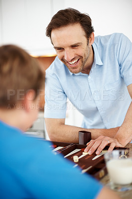 Buy stock photo Portrait of a happy young man enjoying backgammon game with his son - Indoor
