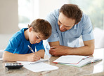 Happy man helping his son to do homework