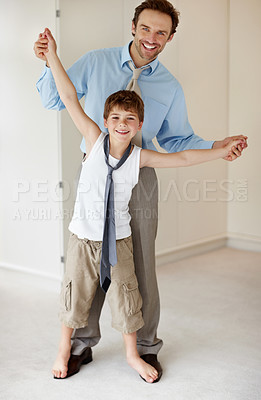 Buy stock photo Portrait of a little young child and his father while dancing