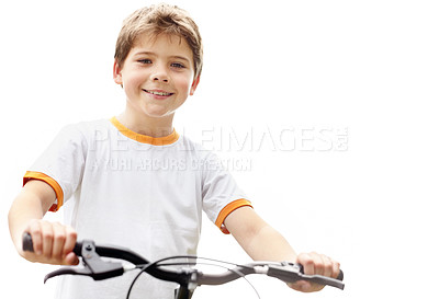 Buy stock photo Portrait of a cute little boy riding bicycle against bright background
