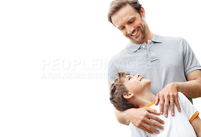 Buy stock photo Portrait of a little young boy and his father looking at each other - Copyspace