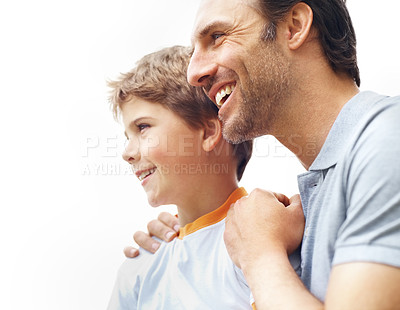 Buy stock photo Portrait of a happy father and son looking at something interesting - Copyspace