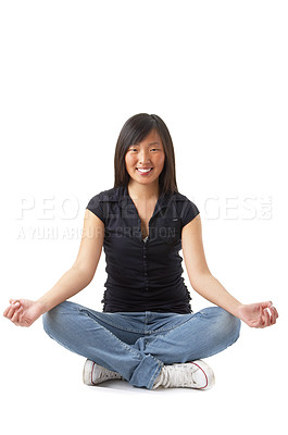 Buy stock photo A young beautiful asian-looking girl meditating in lotus position. Relaxed, and focused on her inner peace. Unique Keyword for this collection is: meditation123