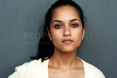 Buy stock photo Closeup portrait of a lovely young female model looking confidently against grey background
