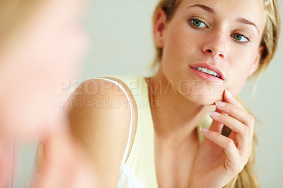 Buy stock photo Closeup portrait of a beautiful young female looking her face in mirror