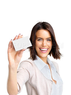 Buy stock photo Portrait of a happy young woman showing her bussiness card against white background