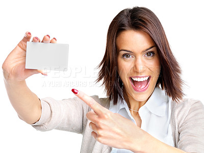 Buy stock photo Portrait of a smiling young woman pointing at blank card in her hand against white background