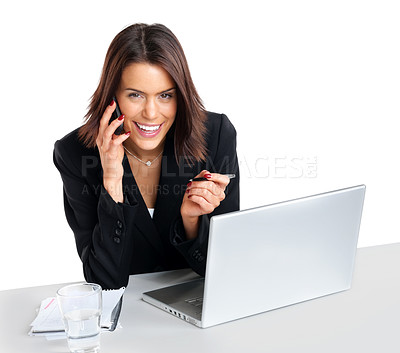 Buy stock photo Portrait of a pretty cheerful young female using mobilephone with laptop in front against white background