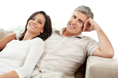 Buy stock photo Portrait of a lovely mature couple sitting together on couch at home