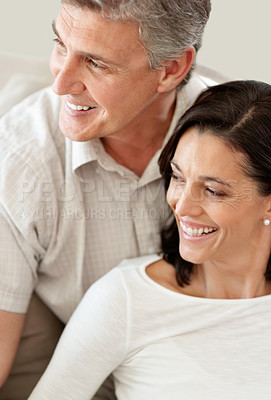 Buy stock photo Portrait of a happy mature couple looking at something interesting