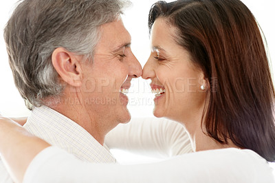 Buy stock photo Closeup portrait of a happy mature couple enjoying themselves