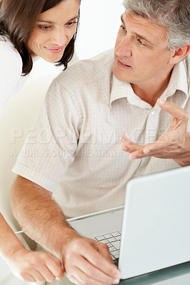 Buy stock photo Portrait of a beautiful mature couple working together on laptop