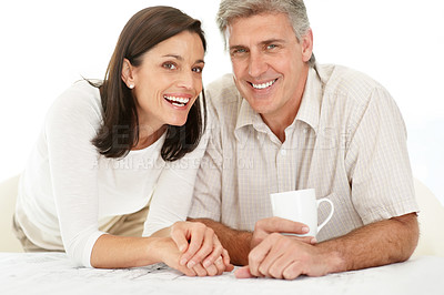 Buy stock photo Portrait of a happy mature man drinking coffee with her wife