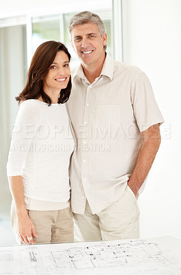 Buy stock photo Portrait of happy mature couple standing together and smiling