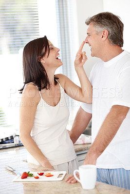 Buy stock photo Portrait of  happy mature female touching her husbands nose