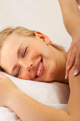 Buy stock photo Shot of a young woman getting a back massage