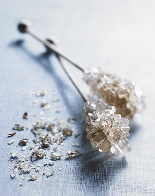Buy stock photo Brown sugar crystals on a stick. A simple an stylistic portrait of european coffee or tea accessory