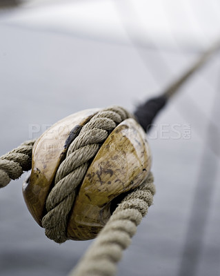 Buy stock photo Close-up shot of a pulley. Taken at a shipyard.