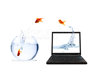 Buy stock photo High resolution image of a goldfish leaping from a laptop into reality. Conceptual image.
